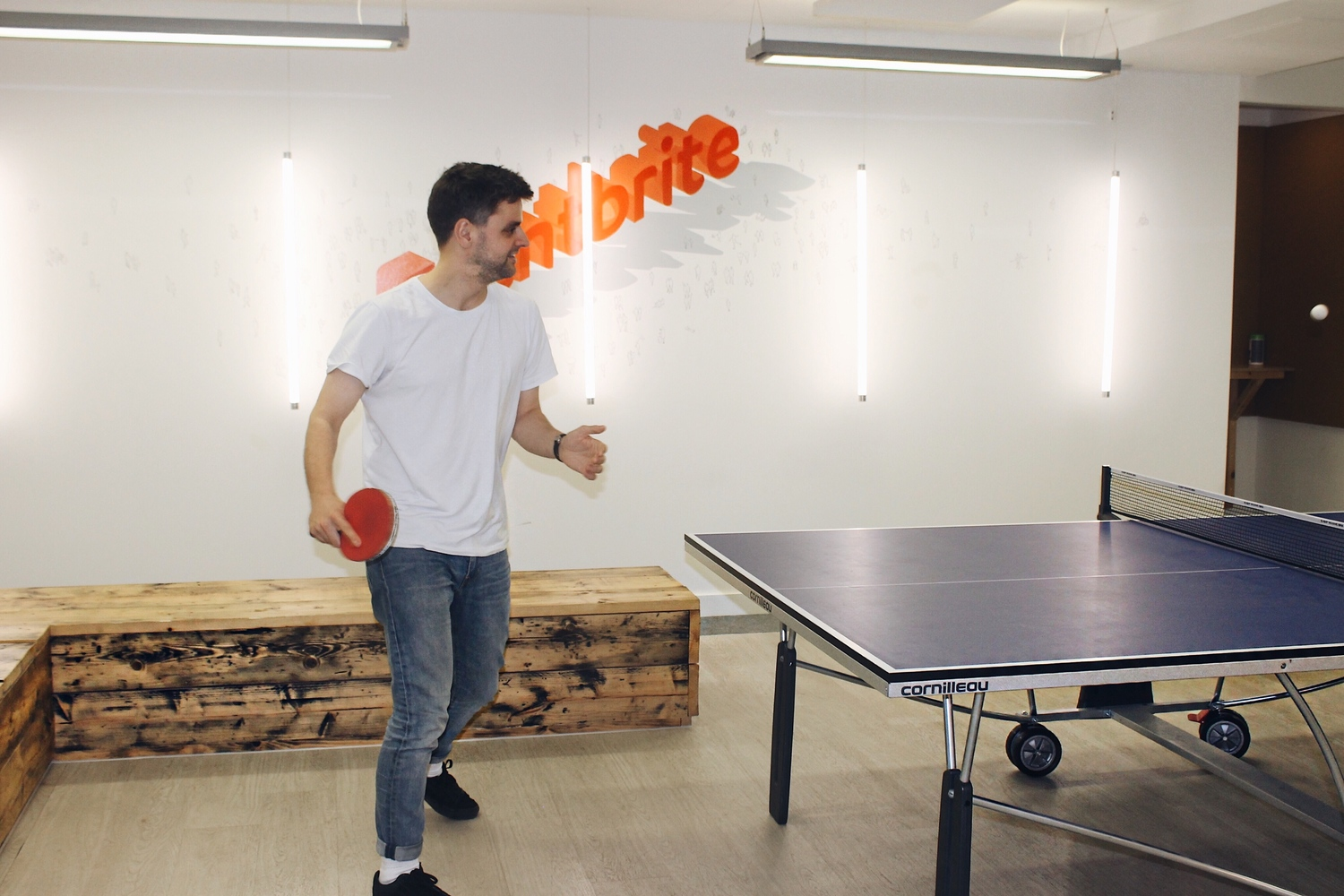 People, Person, Ping Pong, Sport, Sports, Dining Table, Furniture, Table, Clothing, Shoe, Wood, Plywood, Pants, Hardwood, Flooring, Jeans