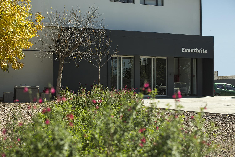 Garden, Outdoors, Bush, Flora, Plant, Vegetation, Car, Transportation, Vehicle, Automobile, Person, Building, Door, Patio, Flower