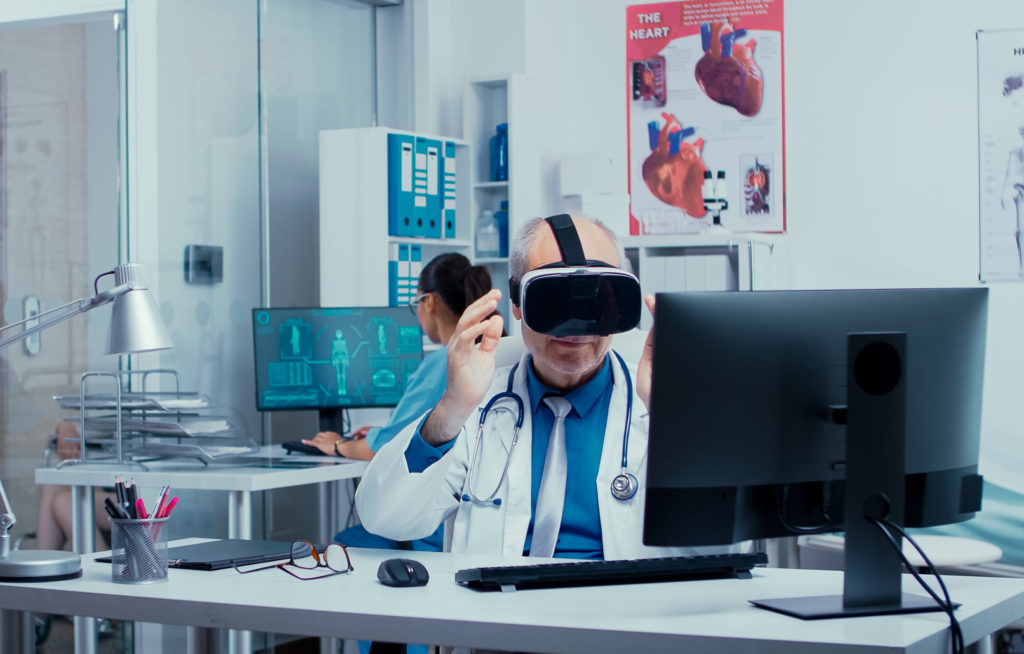 Clothing, Person, Monitor, Electronics, Lab Coat, Coat, Sunglasses, Clinic, Lab, Doctor
