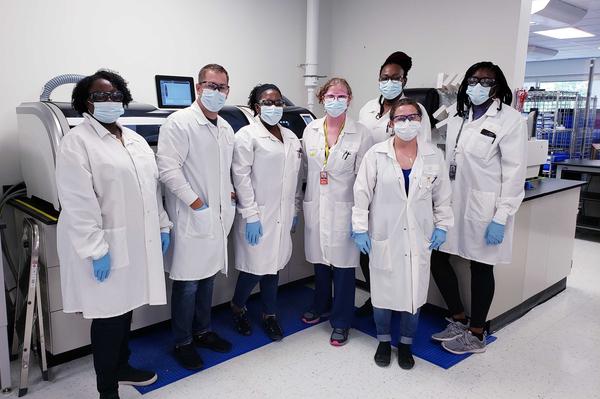 Clothing, Apparel, Lab Coat, Coat, Person, Clinic