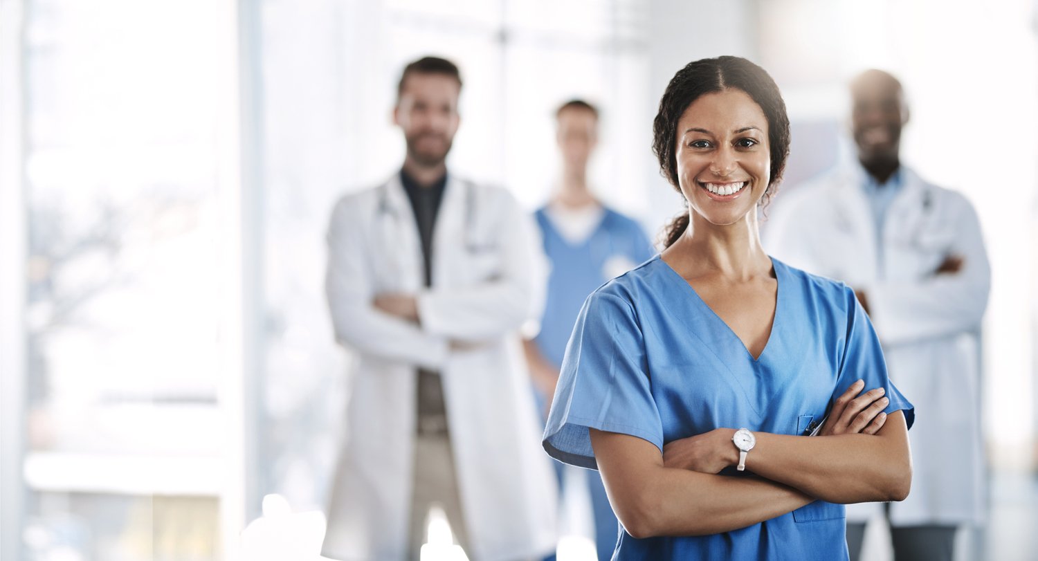 Female Medical Professional with three various professional in background