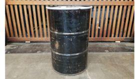 Image of a 55 Gallon Black Metal Drum