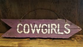 """Image of a """"Cowgirls"""" Sign"""