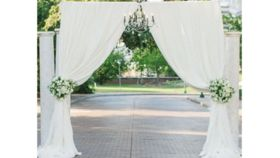 Image of a 07 - Pipe & Drape 2 Post Arch with White Sheer Draping Tieback Indoor